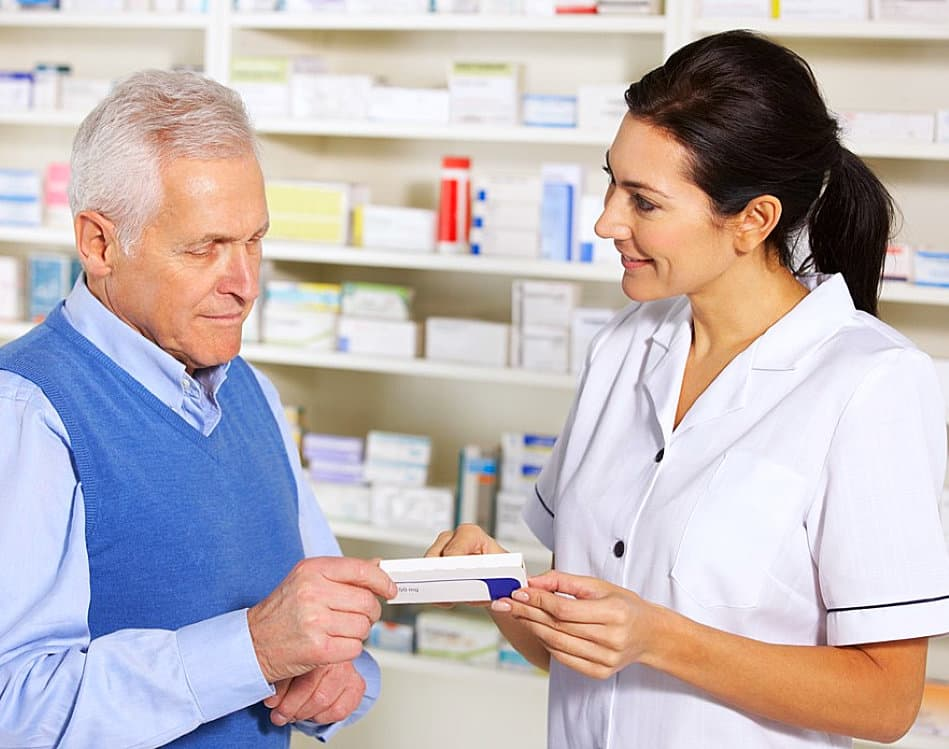 pharmacist and old man talking