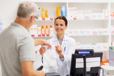 pharmacist giving a medicine to a customer